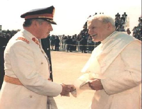Pope John Paul, II welcoming mass murder Augusto Pinochet to the Vatican.